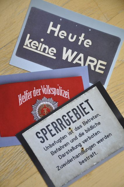 Postcards with old East German signage.
