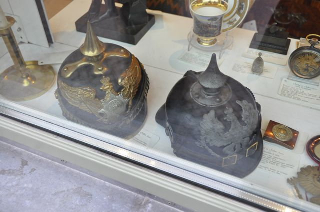 Prussian helmets in a shop window