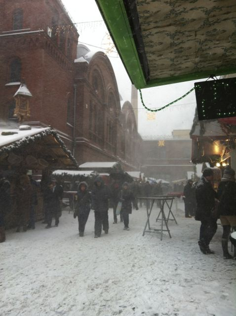 Walking through the Lucia Christmas Market in drifting snow
